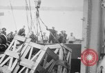Image of a crane unloading military equipment Bordeaux France, 1918, second 10 stock footage video 65675048400