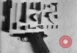 Image of Colt model 1911 semiautomatic pistol United States USA, 1918, second 2 stock footage video 65675048402