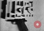 Image of Colt model 1911 semiautomatic pistol United States USA, 1918, second 5 stock footage video 65675048402