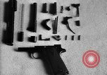 Image of Colt model 1911 semiautomatic pistol United States USA, 1918, second 8 stock footage video 65675048402