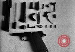 Image of Colt model 1911 semiautomatic pistol United States USA, 1918, second 9 stock footage video 65675048402