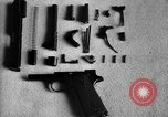 Image of Colt model 1911 semiautomatic pistol United States USA, 1918, second 11 stock footage video 65675048402