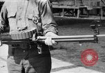 Image of Soldier displays a Lewis machine gun United States USA, 1918, second 1 stock footage video 65675048409