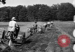Image of rows of tractors United States USA, 1917, second 8 stock footage video 65675048439