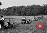 Image of rows of tractors United States USA, 1917, second 10 stock footage video 65675048439