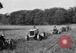 Image of rows of tractors United States USA, 1917, second 12 stock footage video 65675048439