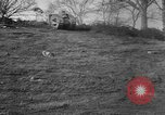 Image of Mark VIII tank driving through a stone wall Bridgeport Connecticut USA, 1918, second 4 stock footage video 65675048450