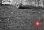 Image of Mark VIII tank driving through a stone wall Bridgeport Connecticut USA, 1918, second 7 stock footage video 65675048450