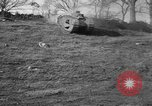 Image of Mark VIII tank driving through a stone wall Bridgeport Connecticut USA, 1918, second 8 stock footage video 65675048450