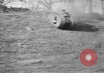 Image of Mark VIII tank driving through a stone wall Bridgeport Connecticut USA, 1918, second 10 stock footage video 65675048450
