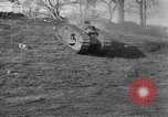 Image of Mark VIII tank driving through a stone wall Bridgeport Connecticut USA, 1918, second 12 stock footage video 65675048450