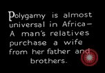 Image of practice of polygamy Africa, 1931, second 9 stock footage video 65675048508