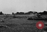 Image of Ford tractor drawn reaper United States USA, 1918, second 12 stock footage video 65675048692