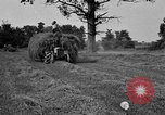 Image of Ford tractor drawn hay wagon United States USA, 1918, second 3 stock footage video 65675048695