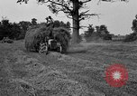 Image of Ford tractor drawn hay wagon United States USA, 1918, second 6 stock footage video 65675048695