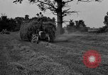 Image of Ford tractor drawn hay wagon United States USA, 1918, second 7 stock footage video 65675048695