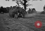 Image of Ford tractor drawn hay wagon United States USA, 1918, second 11 stock footage video 65675048695