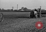 Image of Ford tractor drawn plow United States USA, 1919, second 12 stock footage video 65675048697