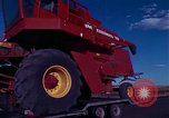 Image of reaper in a field United States USA, 1975, second 2 stock footage video 65675048716