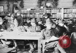 Image of American Army soldiers in YMCA club during World War I European Theater, 1917, second 3 stock footage video 65675048746