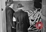Image of German civilians tour Dachau concentration camp after its liberation Bavaria Germany, 1945, second 4 stock footage video 65675049039