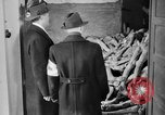 Image of German civilians tour Dachau concentration camp after its liberation Bavaria Germany, 1945, second 5 stock footage video 65675049039