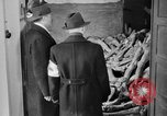 Image of German civilians tour Dachau concentration camp after its liberation Bavaria Germany, 1945, second 6 stock footage video 65675049039