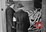 Image of German civilians tour Dachau concentration camp after its liberation Bavaria Germany, 1945, second 8 stock footage video 65675049039