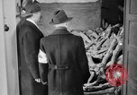 Image of German civilians tour Dachau concentration camp after its liberation Bavaria Germany, 1945, second 9 stock footage video 65675049039