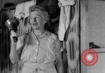 Image of milking a cow United States USA, 1943, second 8 stock footage video 65675049124