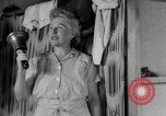 Image of milking a cow United States USA, 1943, second 9 stock footage video 65675049124
