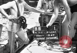 Image of Navy diver entering water United States USA, 1943, second 1 stock footage video 65675049206