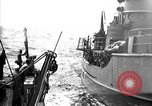 Image of Auxiliary Motor Minesweeper loading Atlantic Ocean, 1943, second 1 stock footage video 65675049218