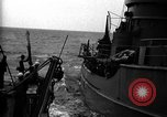 Image of Auxiliary Motor Minesweeper loading Atlantic Ocean, 1943, second 2 stock footage video 65675049218