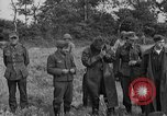 Image of German prisoners of war at a field in France France, 1944, second 11 stock footage video 65675049234