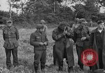 Image of German prisoners of war at a field in France France, 1944, second 12 stock footage video 65675049234
