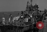 Image of Crew of USS Pilot AM-104 deploys and retrieves cables Chesapeake Bay, 1939, second 3 stock footage video 65675049270