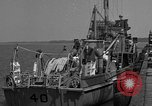 Image of Crew of USS Pilot AM-104 deploys and retrieves cables Chesapeake Bay, 1939, second 6 stock footage video 65675049270