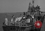 Image of Crew of USS Pilot AM-104 deploys and retrieves cables Chesapeake Bay, 1939, second 7 stock footage video 65675049270