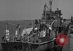 Image of Crew of USS Pilot AM-104 deploys and retrieves cables Chesapeake Bay, 1939, second 8 stock footage video 65675049270