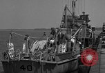 Image of Crew of USS Pilot AM-104 deploys and retrieves cables Chesapeake Bay, 1939, second 9 stock footage video 65675049270