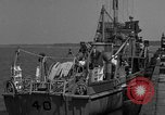 Image of Crew of USS Pilot AM-104 deploys and retrieves cables Chesapeake Bay, 1939, second 10 stock footage video 65675049270