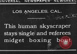 Image of Tall man and midgets Los Angeles California USA, 1930, second 1 stock footage video 65675049604