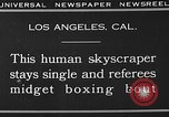 Image of Tall man and midgets Los Angeles California USA, 1930, second 2 stock footage video 65675049604
