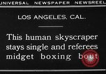 Image of Tall man and midgets Los Angeles California USA, 1930, second 3 stock footage video 65675049604