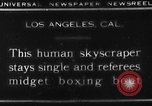 Image of Tall man and midgets Los Angeles California USA, 1930, second 4 stock footage video 65675049604