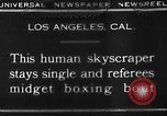 Image of Tall man and midgets Los Angeles California USA, 1930, second 9 stock footage video 65675049604
