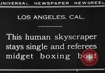 Image of Tall man and midgets Los Angeles California USA, 1930, second 10 stock footage video 65675049604