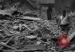 Image of Clearing debris after blitz United Kingdom, 1940, second 1 stock footage video 65675049638