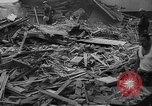 Image of Clearing debris after blitz United Kingdom, 1940, second 2 stock footage video 65675049638